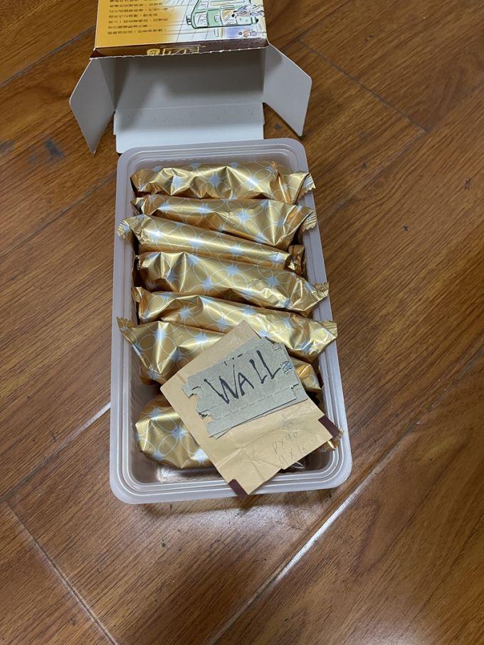 藏在点心盒中白色小纸片却是新型毒品.jpg